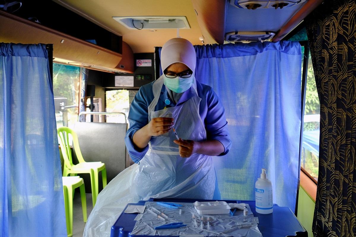 Malaysia apologizes for 'human error' over empty Covid-19 vaccine jab