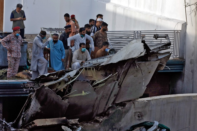 Death toll from Pakistan airliner crash 97, two survivors