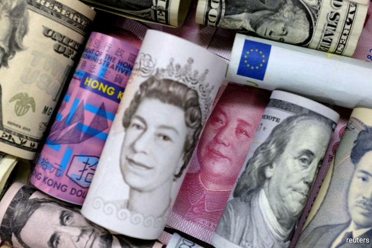 Asian currencies slid on Monday as the rapid spread of the coronavirus outside China drove fears. (Photo by Reuters)