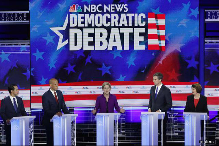 Democrats clash on healthcare, border in scrappy first U.S. presidential debate
