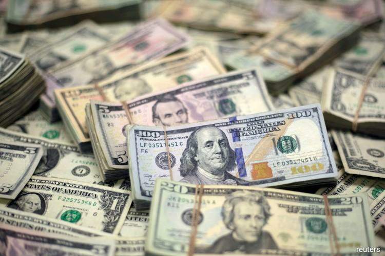The dollar index against a basket of major six currencies =USD stood flat at 99.588 after a gain of 0.53% overnight as the U.S. currency advanced against most of its major peers. (Photo by Reuters)
