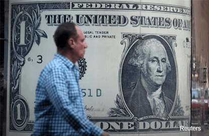 Dollar subdued after U.S. wage growth disappoints