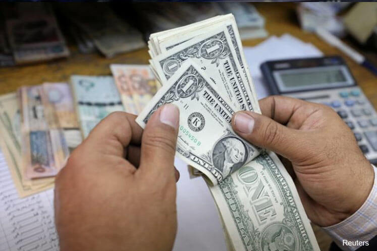 Dollar on track for winning week as US jobs data awaited, euro firm