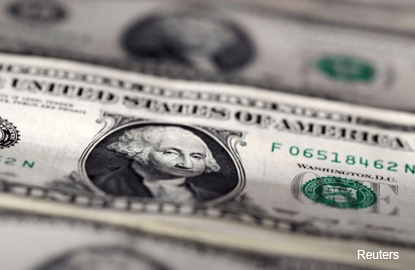 Dollar droops after strong data fail to lift U.S. yields