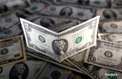US dollar sinks to lowest in a month