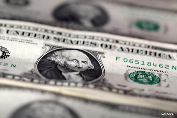 Dollar sinks to lowest in a month