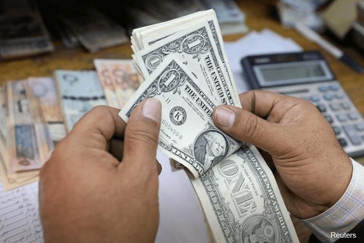 Dollar on defensive for packed week of Fed speakers