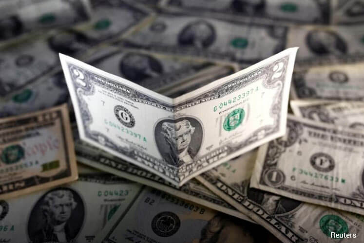 Dollar limps away from multi-month lows, still seen vulnerable
