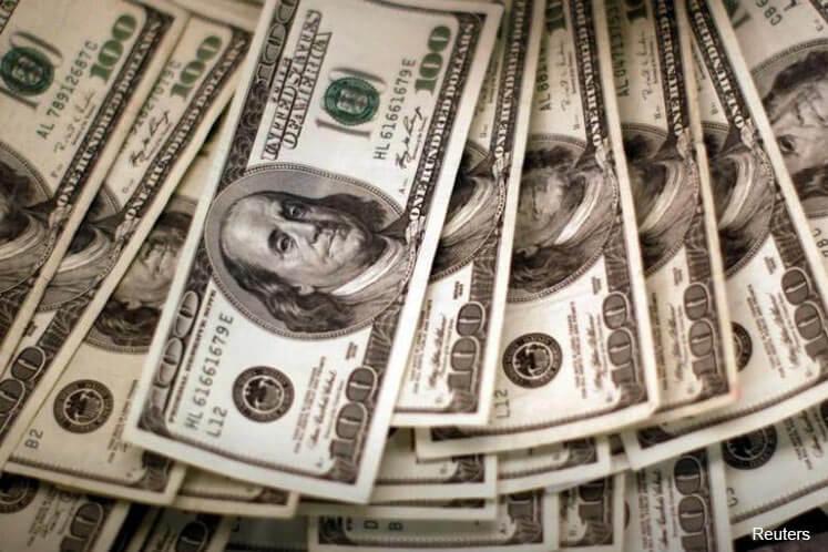 Dollar continues slump, but outlook still upbeat