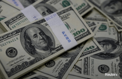 Dollar pulls away from lows as investors await Yellen speech