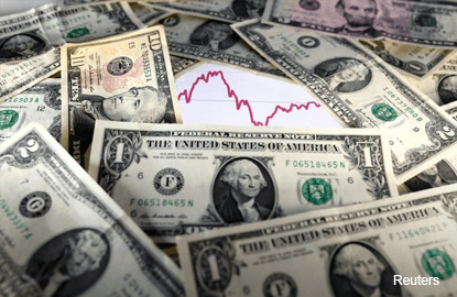 Dollar inches higher, eyes on trade numbers