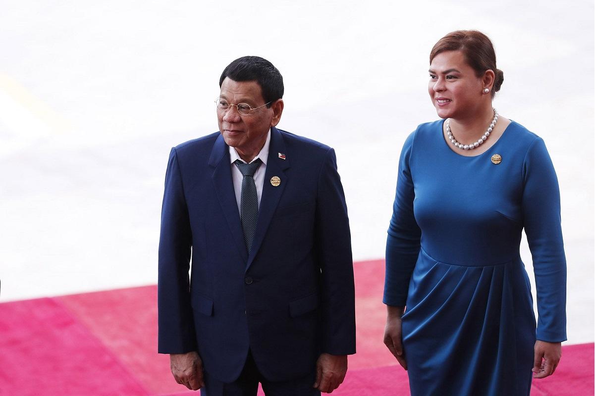 Philippine leader Rodrigo Duterte with his daughter Sara Duterte (Photo by Bloomberg)