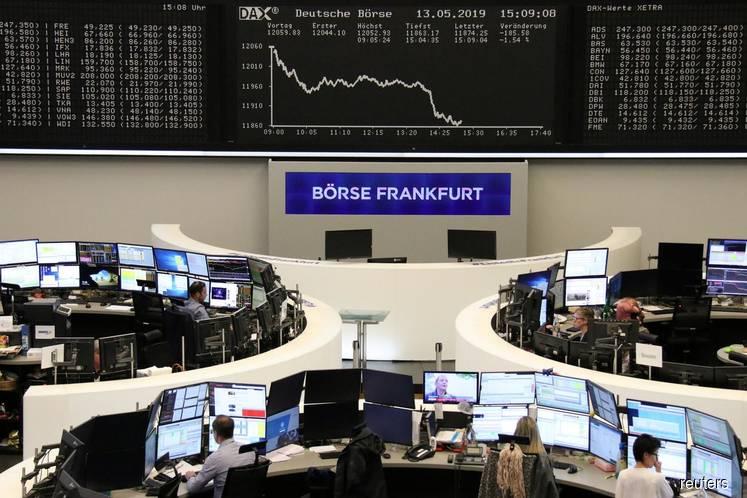 European shares drop on growth fears, London slides on fresh Brexit drama