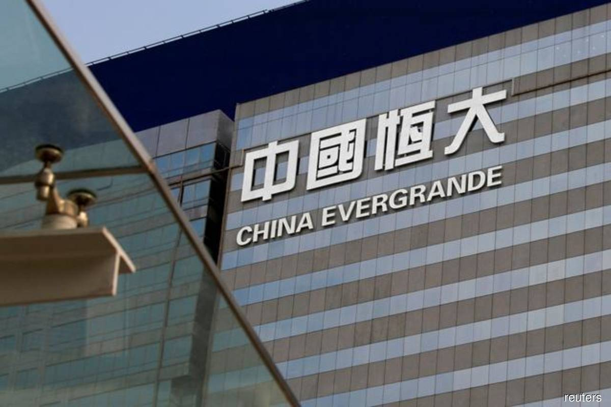 Evergrande tries to stop bond, stock rout from spiraling