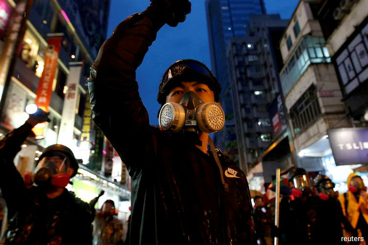 China's action could spark fresh protests in Hong Kong, which enjoys many freedoms not allowed on the mainland, after often violent demonstrations of 2019 plunged the city into its deepest turmoil since it returned to Beijing's rule in 1997. (Photo by Reuters)
