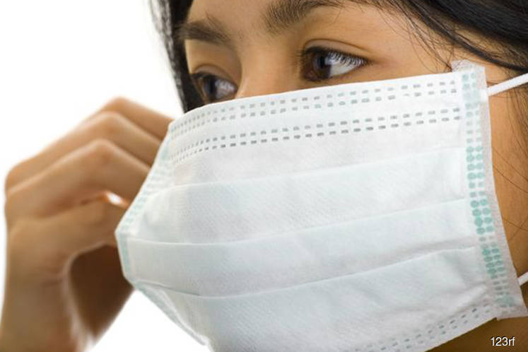 Across Asia, countries race to boost face mask supplies