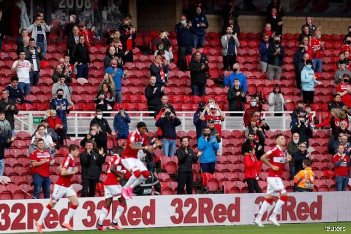 Face masks and no hugging for returning Premier League fans
