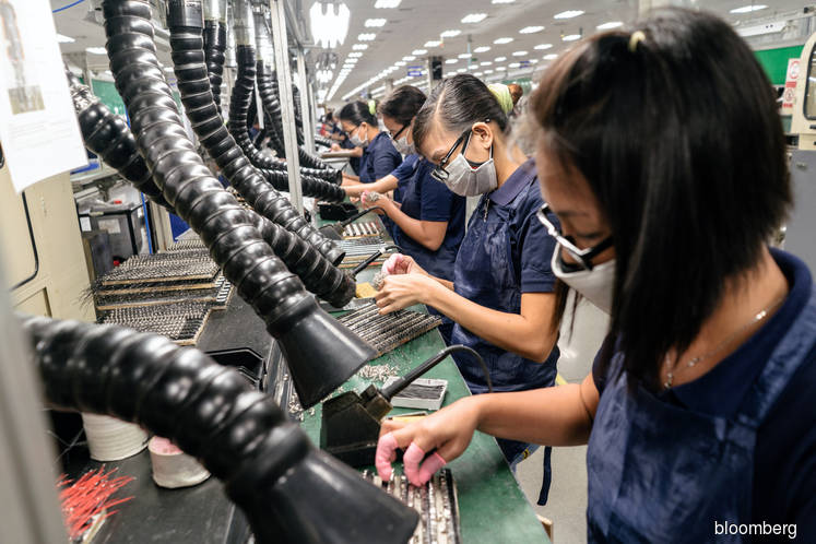 Manufacturing output slows to seven month low