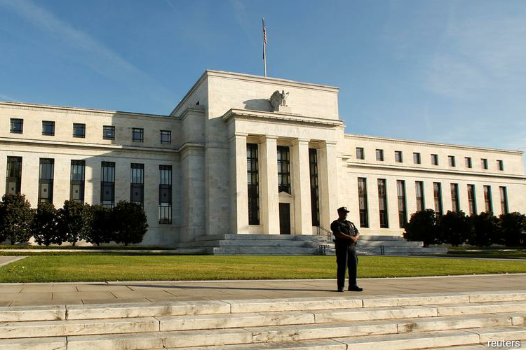 Fed funds futures, which are a gauge of where markets expect the Fed's benchmark overnight lending rate to be, are now pricing in a slightly negative rate environment beginning in December. (Photo by Reuters)