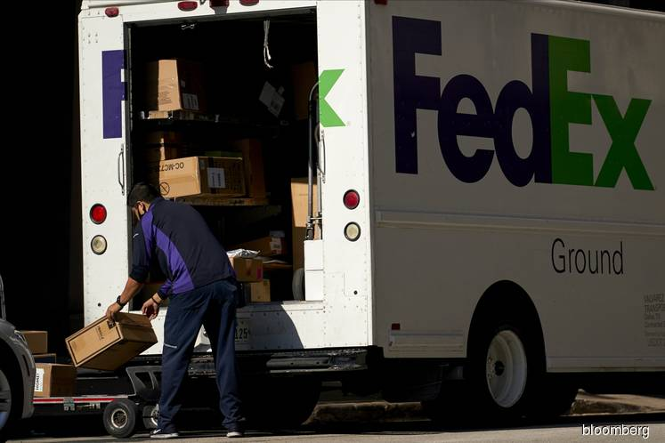 FedEx jumps after profit surprise on cost cuts, health shipments