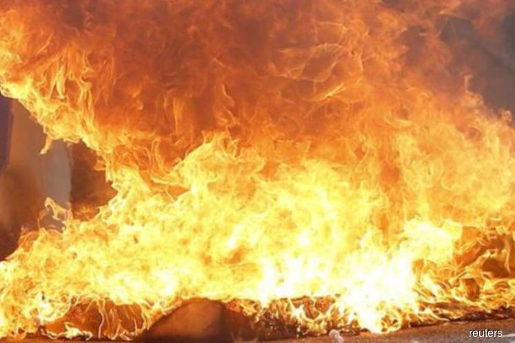 Aluminium dross chemical waste catches fire in Pontian