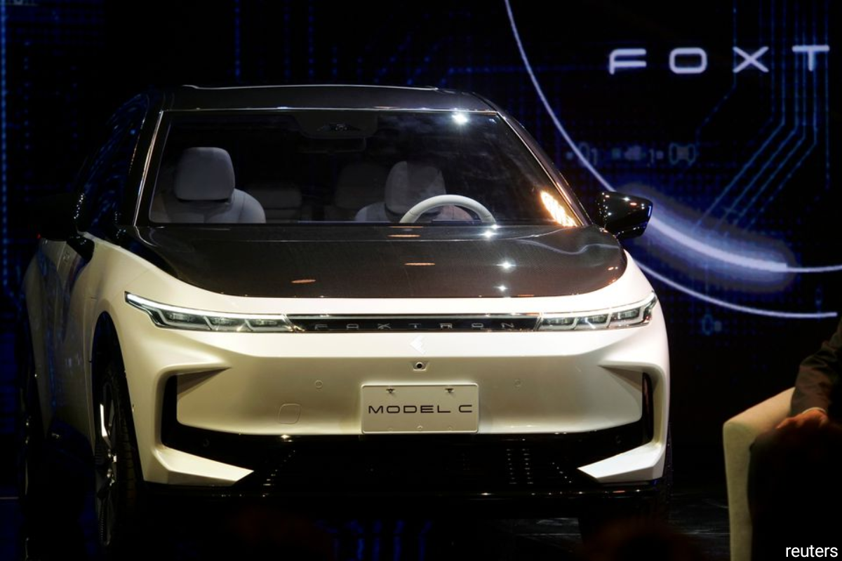 The vehicles — a sport utility vehicle, a sedan, and a bus — were made by Foxtron, a venture between Foxconn and Taiwanese carmaker Yulon Motor Co Ltd.