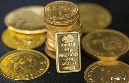 Gold falls on dollar pressure after hawkish Fed comments
