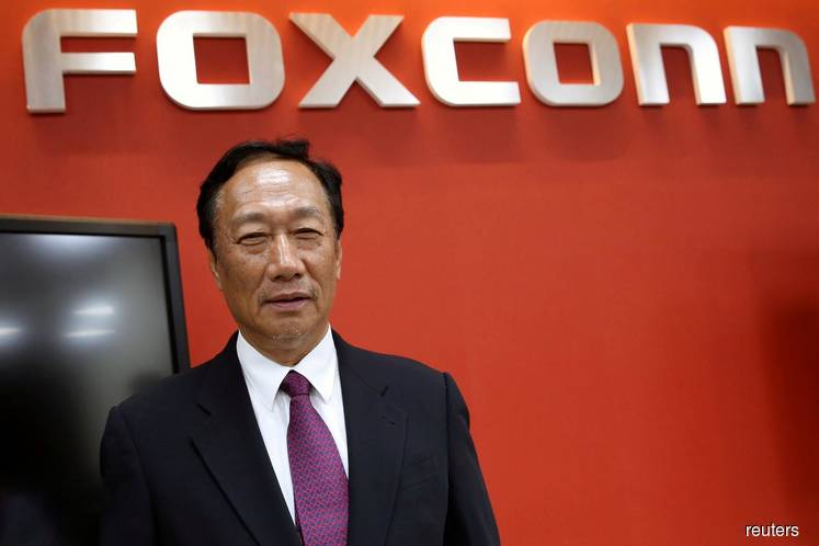 Foxconn's billionaire founder urges Apple to move plants from China