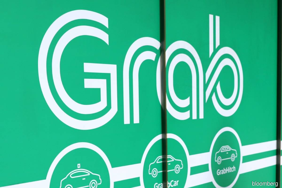 Grab loss narrows on food delivery ahead of US SPAC merger