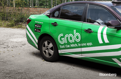 Ride-hailing firms Grab, Uber pursue growth in Myanmar