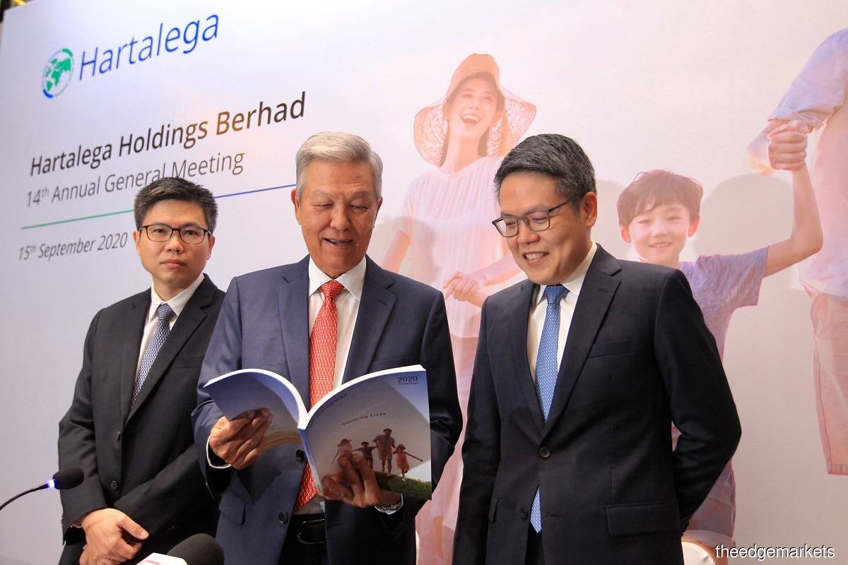 Executive chairman Kuan Kam Hon (centre), chief executive officer Kuan Mun Leong (right), and non-independent executive director Kuan Mun Keng (left) at Hartalega Holdings Bhd's 14th annual general meeting yesterday.