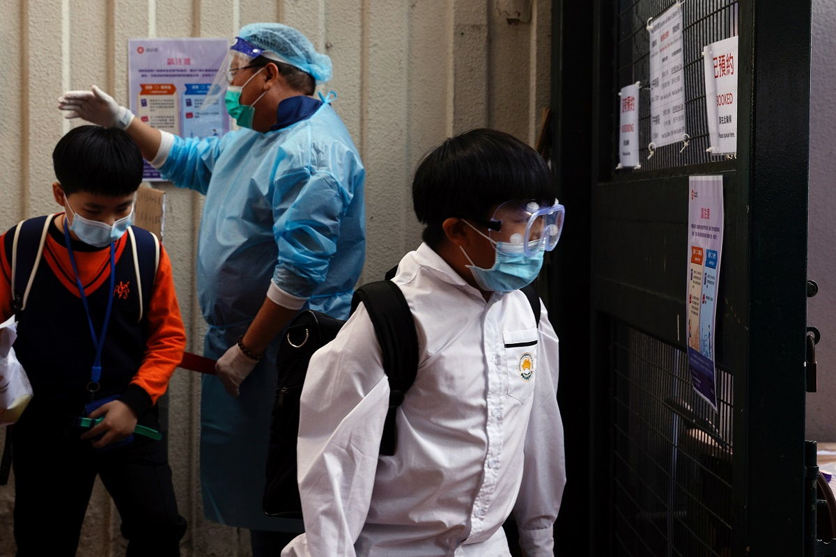 Students enter into a makeshift community testing centre for Covid-19, in Hong Kong, China, Nov 30, 2020. (Photo by Reuters)