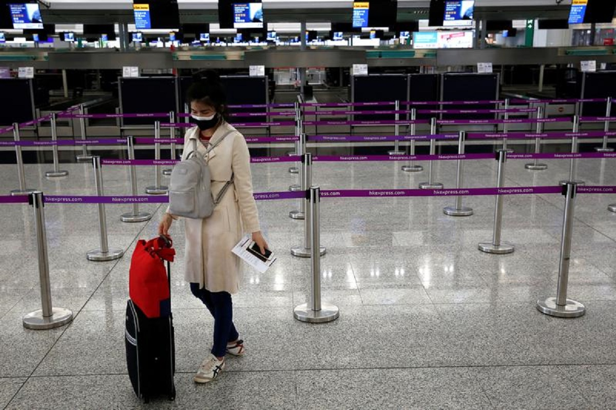 A passenger at Hong Kong International Airport, Hong Kong, China, on March 17, 2020. (File photo by Reuters)