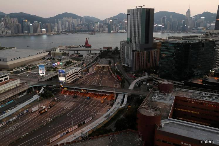 Hong Kong authorities appeal for calm as major highway reopens