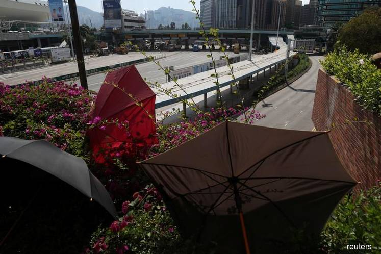 Hong Kong university siege winds down as hunt for protesters comes up empty