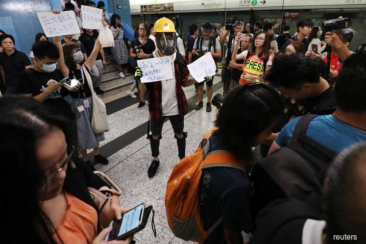 Hong Kong protests spread to subway as bank warns of economic fallout