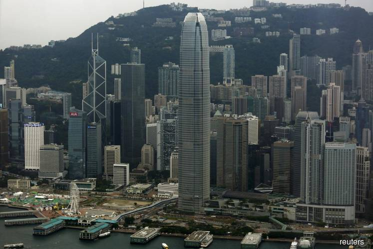 China warns foreign forces against 'conniving' in Hong Kong