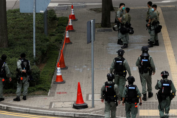 Details of the new Chinese legislation, which could see mainland security agencies to set up operations in Hong Kong, are being deliberted this week by China's parliament. (Photo by Reuters)