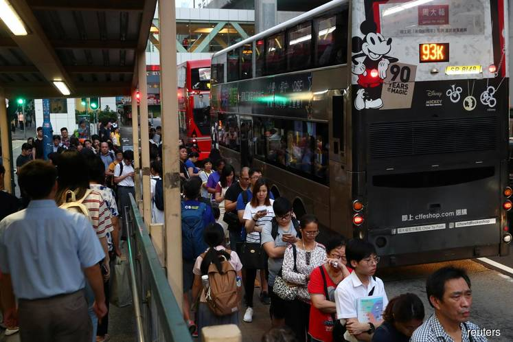 Hong Kong shopping malls, metro close early as more protests planned