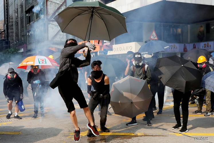 Hong Kong leader to visit Japan after huge rally, night of violence