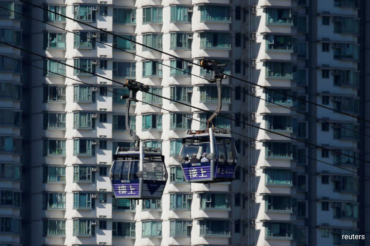 For properties priced above HK$10 million, a 50% downpayment is still required. (Photo by Reuters)