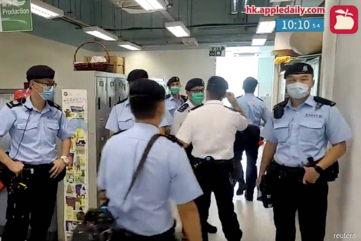 A still image taken from a social-media live feed showing police's raid on Apple Daily's office in Hong Kong today.
