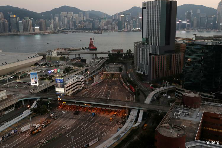 Hong Kong economy shrinks for first time in a decade