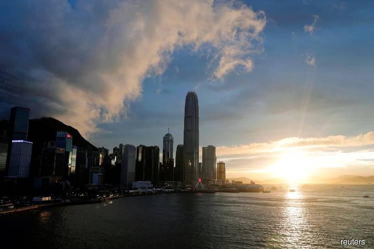 Hong Kong facing 'tsunami-like' shocks, finance chief says