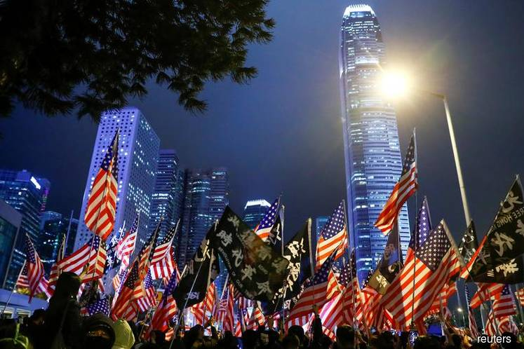 China warns US over Hong Kong law as thousands stage 'Thanksgiving' rally