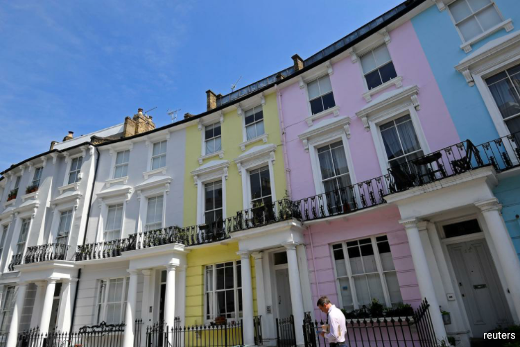 Halifax said house prices in March were flat month-on-month - the first time they did not rise in five months - after a 0.2% rise in February. (Photo by Reuters)