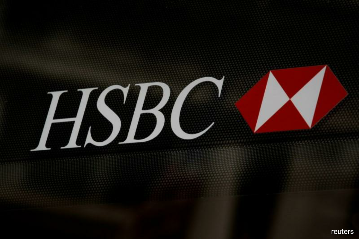 HSBC curbs profit and payout ambitions, targets Asia wealth