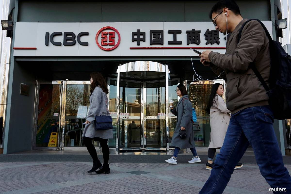 China's largest lenders post lower 3Q profits as bad loans rise