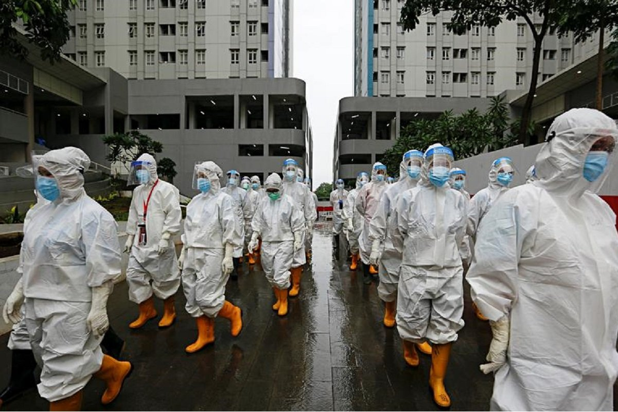 Health experts believe the true spread of the virus in Indonesia could be three times higher. (Photo by Reuters)