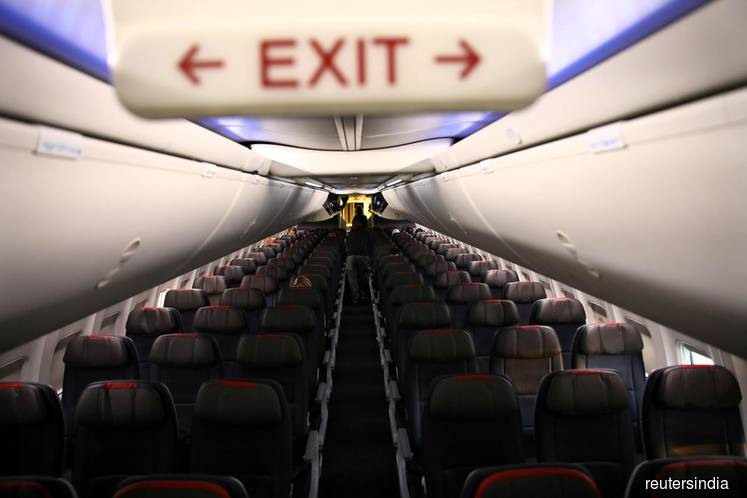 Coronavirus grounds more flights, takes toll on jobs